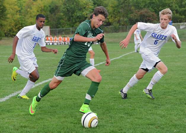 Shenendehowa's Drew Lewis runs with the ball followed closely by Shaker's Matt JeanPierre, left, and Brennan Jelstrom during a soccer game on Tuesday, Sept. 23, 2014 in Latham, N.Y. (Lori Van Buren / Times Union) Photo: Lori Van Buren, Albany Times Union / 00028697A