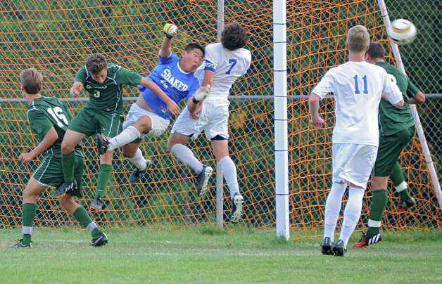 Shaker goalie Mick Keilen makes a save by punching the ball away during a soccer game against Shenendehowa on Tuesday, Sept. 23, 2014 in Latham, N.Y. (Lori Van Buren / Times Union) Photo: Lori Van Buren, Albany Times Union / 00028697A