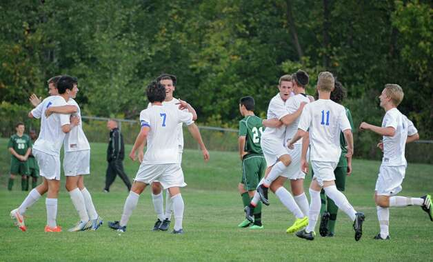 Shaker players celebrate after defeating Shenendehowa in a soccer game on Tuesday, Sept. 23, 2014 in Latham, N.Y. (Lori Van Buren / Times Union) Photo: Lori Van Buren, Albany Times Union / 00028697A