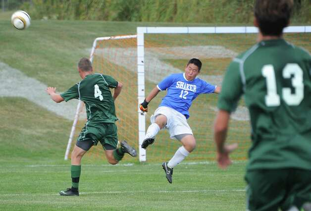 Shaker goalie Mick Keilen makes a save by kicking the ball during a soccer game against Shenendehowa on Tuesday, Sept. 23, 2014 in Latham, N.Y. (Lori Van Buren / Times Union) Photo: Lori Van Buren, Albany Times Union / 00028697A