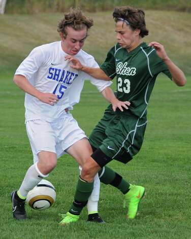 Shaker's Carter Haydock battles for the ball with Shenendehowa's Adel Cekic during a soccer game on Tuesday, Sept. 23, 2014 in Latham, N.Y. (Lori Van Buren / Times Union) Photo: Lori Van Buren, Albany Times Union / 00028697A