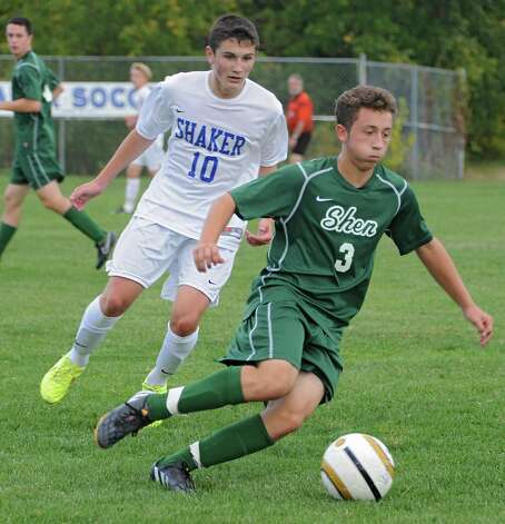 Shaker's Sean Larkin defends Shenendehowa's Michael Miner during a soccer game on Tuesday, Sept. 23, 2014 in Latham, N.Y. (Lori Van Buren / Times Union) Photo: Lori Van Buren, Albany Times Union / 00028697A