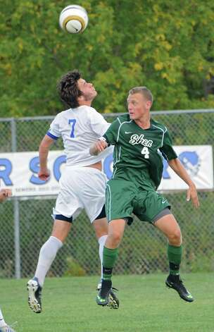 Shaker's Greg Milnarik goes up for a header with Shenendehowa's Tucker Marvin during a soccer game on Tuesday, Sept. 23, 2014 in Latham, N.Y. (Lori Van Buren / Times Union) Photo: Lori Van Buren, Albany Times Union / 00028697A