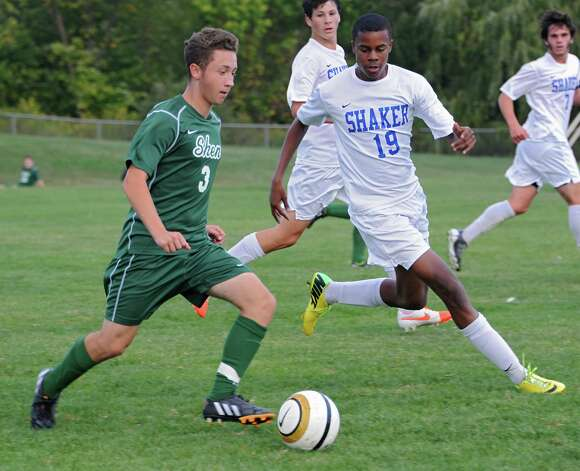 Shenendehowa's Michael Miner runs with the ball followed closely by Shaker's Matt JeanPierre during a soccer game on Tuesday, Sept. 23, 2014 in Latham, N.Y. (Lori Van Buren / Times Union) Photo: Lori Van Buren, Albany Times Union / 00028697A