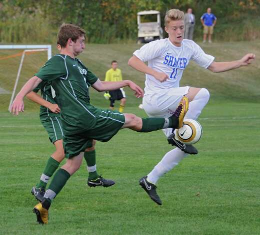 Shenendehowa's Anthony Romeo battles for the ball with Shaker's Tommy Jelstrom during a soccer game on Tuesday, Sept. 23, 2014 in Latham, N.Y. (Lori Van Buren / Times Union) Photo: Lori Van Buren, Albany Times Union / 00028697A