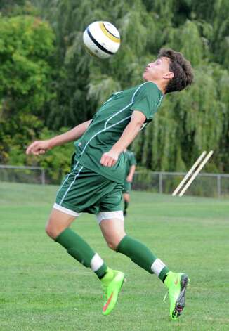 Shenendehowa's Drew Lewis stops the ball with his chest during a soccer game against Shaker on Tuesday, Sept. 23, 2014 in Latham, N.Y. (Lori Van Buren / Times Union) Photo: Lori Van Buren, Albany Times Union / 00028697A