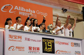 Alibaba employees celebrate during the opening bell ceremony at the New York Stock Exchange last week. The IPO was the largest in history.