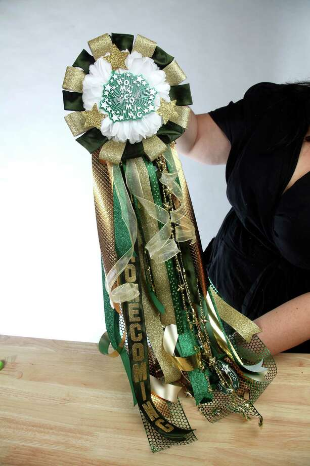 The finished homecoming mum is layered with many colors, shapes and trinkets that make it a keepsake worth saving. Photo: San Antonio Express-News / San Antonio Express-News