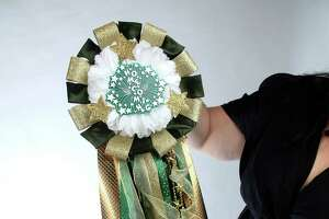 The finished homecoming mum is layered with many colors, shapes and trinkets that make it a keepsake worth saving.