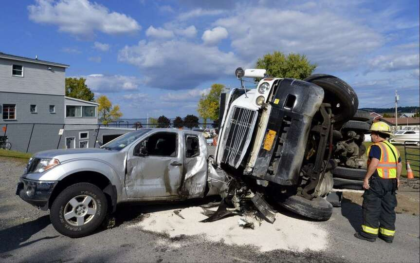 A dump truck is seen after a collision with a pickup truck in Malta Wednesday Sept. 24. (Skip Dickst