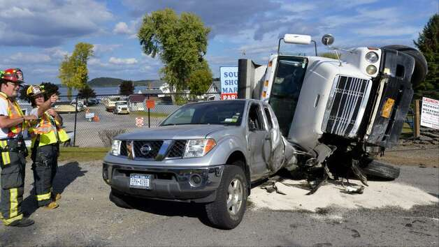 A dump truck is seen after a collision with a pickup truck in Malta Wednesday Sept. 24. (Skip Dickstein / Times Union)