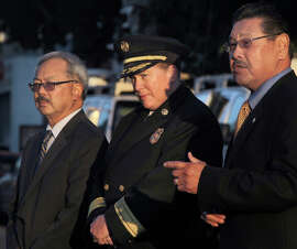 Fire Chief Joanne Hayes- White is joined by Mayor Ed Lee and Fire Com mission President Stephen Nakajo during a ceremony at Fire Station 7 in San Francisco, Calif. on Thursday, Sept. 11, 2014 to remember the first responders who perished in the terrorist attack on the World Trade Center in New York City 13 years ago.
