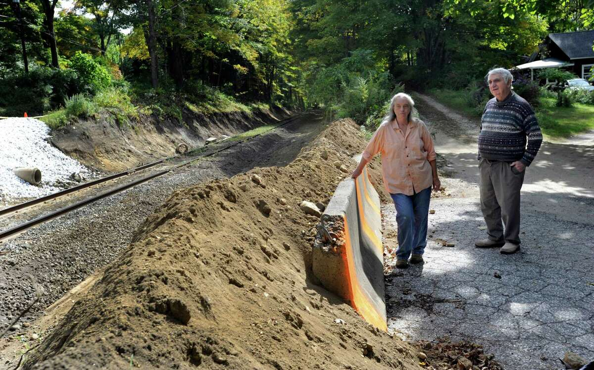 Susan Grisell, 68, and Richard Stalter, 80, residents of Waller Road in Gaylordsville stand at the railroad crossing that is closed off by the Housatonic Railroad as repairs are being made Wed., Sept. 24, 2014.