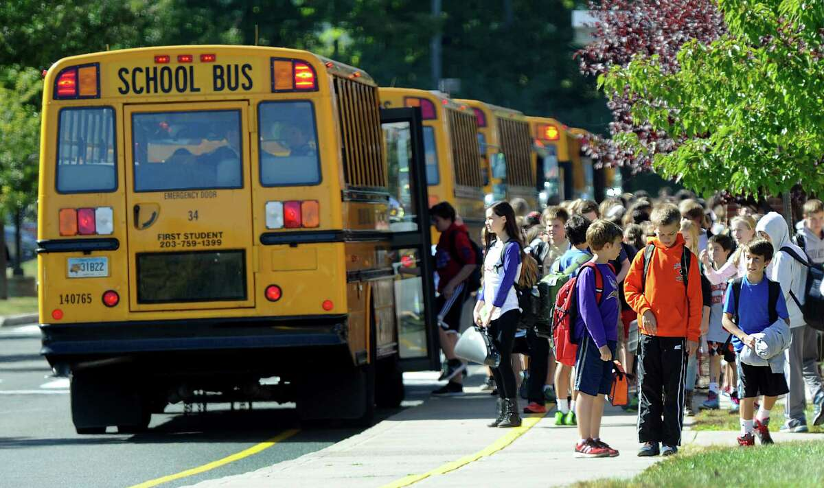 Buses are lined up at the end of the school day at Scotts Ridge Middle School in Ridgefield, Conn., Tuesday, Sept. 23, 2014.