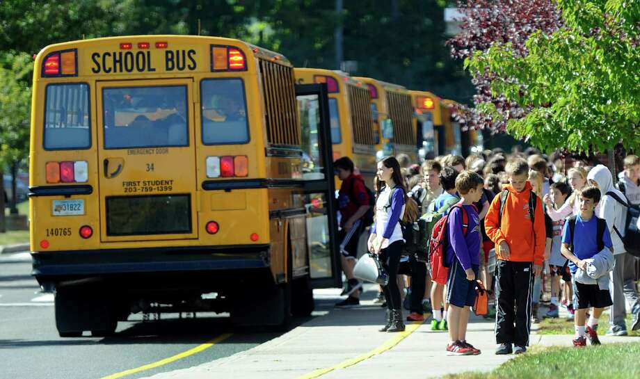Buses are lined up at the end of the school day at Scotts Ridge Middle School in Ridgefield, Conn., Tuesday, Sept. 23, 2014. Photo: Carol Kaliff / The News-Times