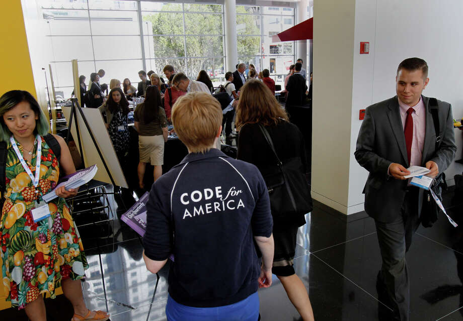 Code for America attendees pick up their credentials. Photo: Brant Ward, Staff Photographer / The Chronicle / ONLINE_YES