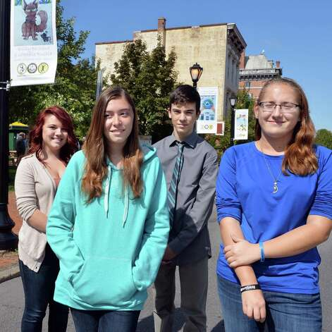 Winning Cohoes students of the Safe Summer Poster Contest, from left, Carrissa Bushey, 18, Emily Bechand, 15, Devon LaBlanc, 13, and Gabrielle Rushia, 15 during a ceremony at Canal Square Wednesday Sept. 24, 2014, in Cohoes, NY.    (John Carl D'Annibale / Times Union) Photo: John Carl D'Annibale / 00028735A
