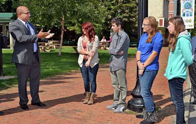 Albany County District Attorney David Soares, left, congratulates winning Cohoes students of the Safe Summer Poster Contest, from left, Carrissa Bushey, 18, Devon LaBlanc, 13, Gabrielle Rushia, 15 and Emily Bechand, 15, during a ceremony at Canal Square Wednesday Sept. 24, 2014, in Cohoes, NY.    (John Carl D'Annibale / Times Union) Photo: John Carl D'Annibale / 00028735A