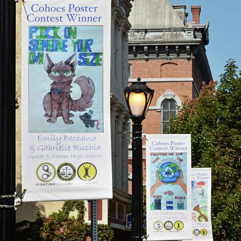The winning entries in Cohoes'  Safe Summer Poster Contest are displayed along Remsen Street at Canal Square Wednesday Sept. 24, 2014, in Cohoes, NY.    (John Carl D'Annibale / Times Union) Photo: John Carl D'Annibale / 00028735A
