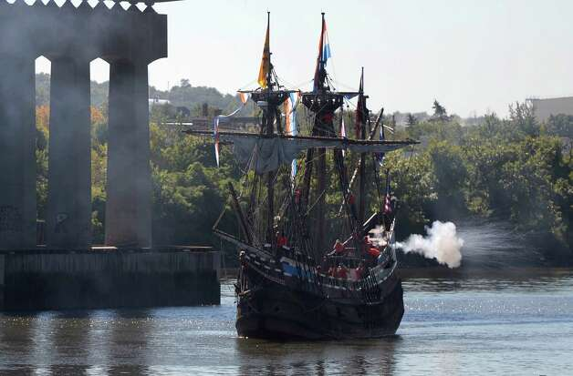 The replica of Henry Hudson's ship the Half Moon fires off a cannon as it arrives a it's mooring at the Corning Preserve this morning Sept 19, 2013 in Albany, N.Y.   (Skip Dickstein/Times Union) Photo: SKIP DICKSTEIN / 00023939A