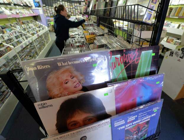 A customer goes through stacks of vinyl records at the Last Vestage show Friday afternoon Sept. 12, 2014 in Albany, N.Y.  (Skip Dickstein/Times Union) Photo: SKIP DICKSTEIN / 00028590A