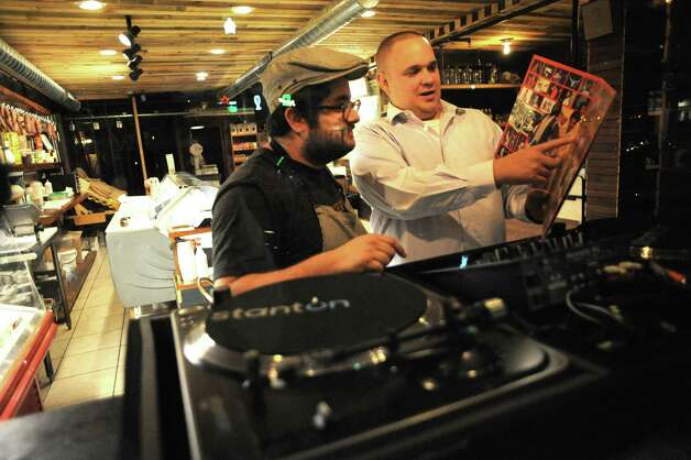 Andrew Siskind, left, and Jared Kingsley run a club for vinyl record fans at The Grocery on Tuesday Sept. 16, 2014 in Troy, N.Y. (Michael P. Farrell/Times Union) Photo: Michael P. Farrell / 00028608A
