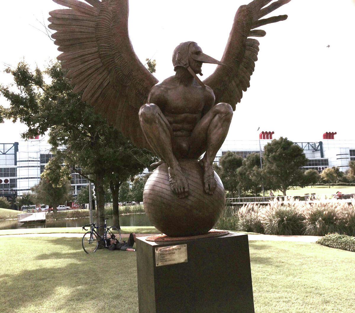 This bronze sculpture, Oriental Bernard, by Mexican artist Jorge Marin, is on display at Discovery Green, Sept. 24, 2014. (Carol Christian / Houston Chronicle)