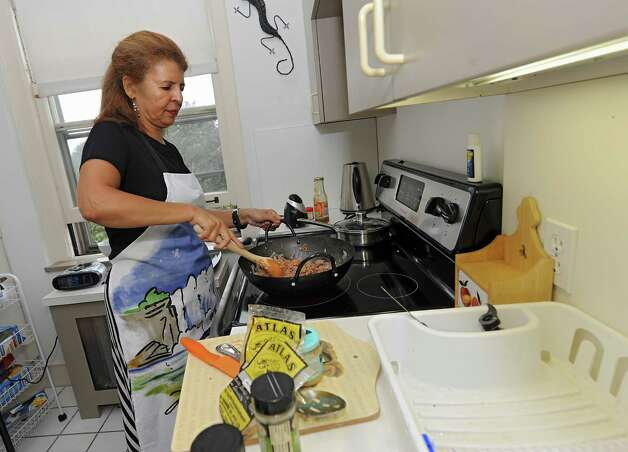Penny Andrews, originally from South Africa, makes a South African dish in her home on Thursday, Sept. 11, 2014 in Albany, N.Y. (Lori Van Buren / Times Union) ORG XMIT: MER2014092215130852 Photo: Lori Van Buren / 00028384A