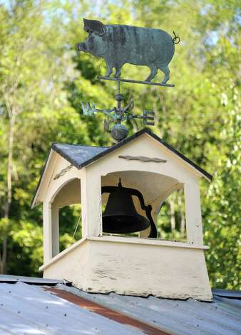 A bell and weathervane are seen on the roof at the Bees Knees Cafe which serves farm-to-table food at Heather Ridge Farm on Friday, Sept. 12, 2014 in Preston Hollow, N.Y. (Lori Van Buren / Times Union) Photo: Lori Van Buren / 00028534A