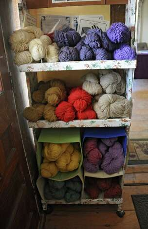 Yarn is seen on shelves in the hallway outside the Bees Knees Cafe at Heather Ridge Farm which serves farm-to-table food on Friday, Sept. 12, 2014 in Preston Hollow, N.Y. (Lori Van Buren / Times Union) Photo: Lori Van Buren / 00028534A