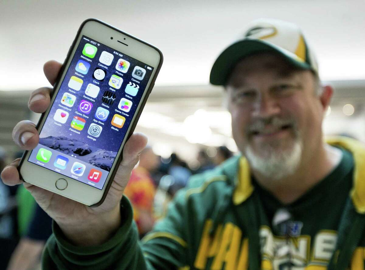 John Mihalkovic of Virginia Beach, Va., shows off his iPhone 6 Plus last week. It appears Apple doesn't understand that some users like to customize their expensive devices.