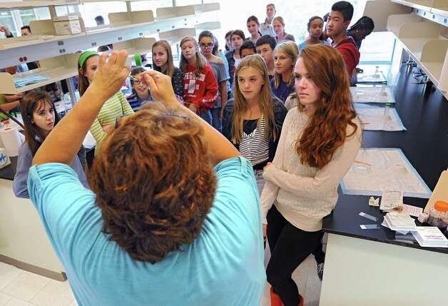 Lab Manager Susan Goderie explains to Robert C. Parker School students how to scrap the inside of their cheek and put their cells on a slide as the students visit the Neural Stem Cell Institute on Wednesday, Sept. 24, 2014 in Rensselaer, N.Y. The student then fed their cells with solutions and looked at the cells including the nucleus under a microscope. (Lori Van Buren / Times Union) Photo: Lori Van Buren / 00028736A