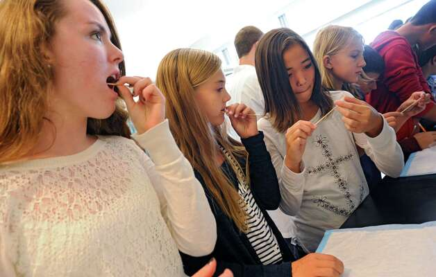 From left, Robert C. Parker School students Megan Cosgrove, 13, Marissa DeMarino, 11, Anna Boggess, 13, and Grace Gundrum, 11 scrap the inside of their cheeks and put their cells on a slide as the students visit the Neural Stem Cell Institute on Wednesday, Sept. 24, 2014 in Rensselaer, N.Y. The student then fed their cells with solutions and looked at the cells including the nucleus under a microscope. (Lori Van Buren / Times Union) Photo: Lori Van Buren / 00028736A