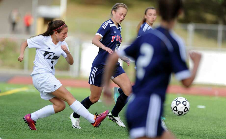 Law's Bethany Edwards drives the ball down the field on her way to a goal during their game against Foran Wednesday, Sept. 24, 2014, at Jonathan Law High School in Milford, Conn. Photo: Autumn Driscoll / Connecticut Post