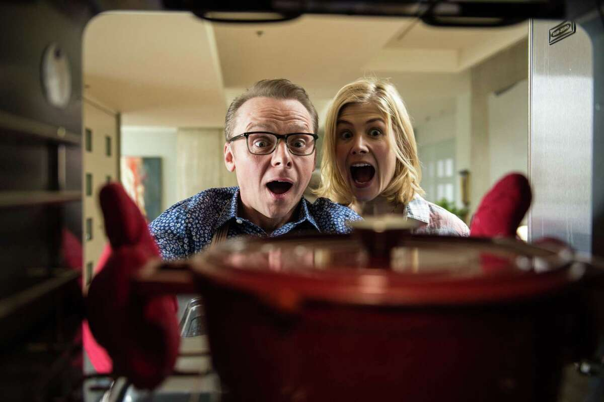 """Rosamund Pike (right) and Simon Pegg star in """"Hector and the Search for Happiness."""""""