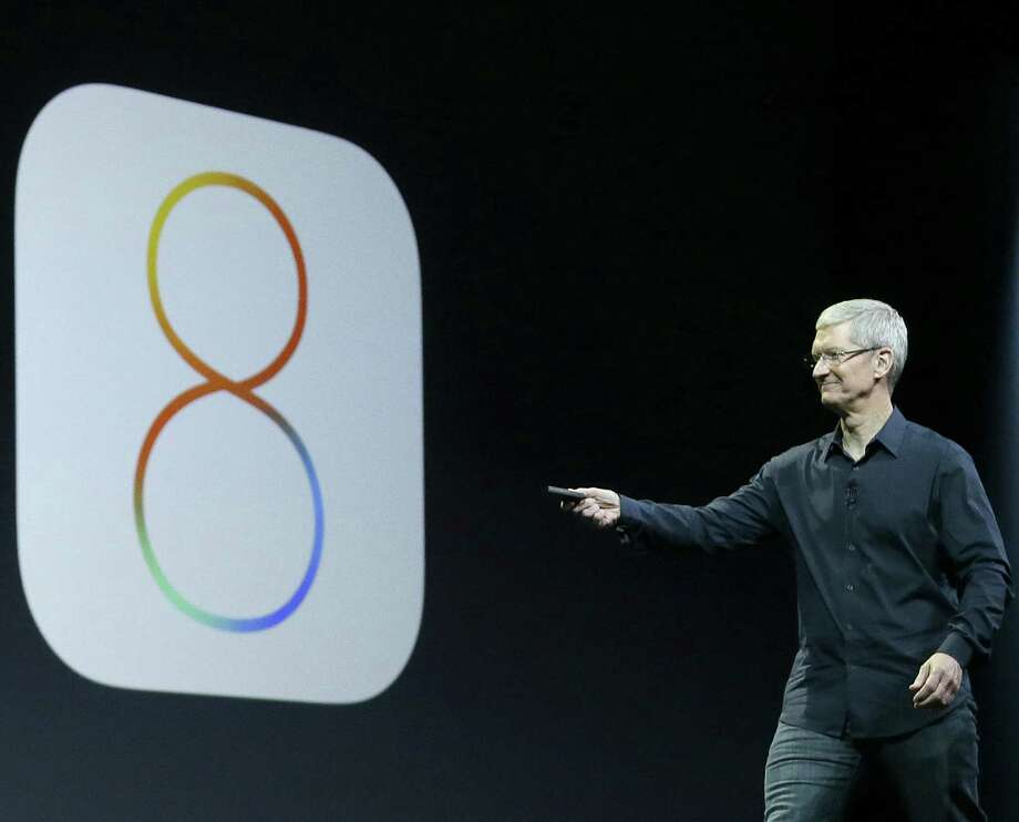 Apple CEO Tim Cook speaks about iOS 8 in June. The company has withdrawn an update to its operating system for the iPhone after scores of customers experienced dropped service. Photo: Associated Press File Photo / AP