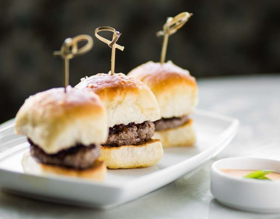 Beef Sliders, caramelized onions, Reef Yeast Rolls, siracha remoulade at Reef, Houston. Photo: ( Nick De La Torre )