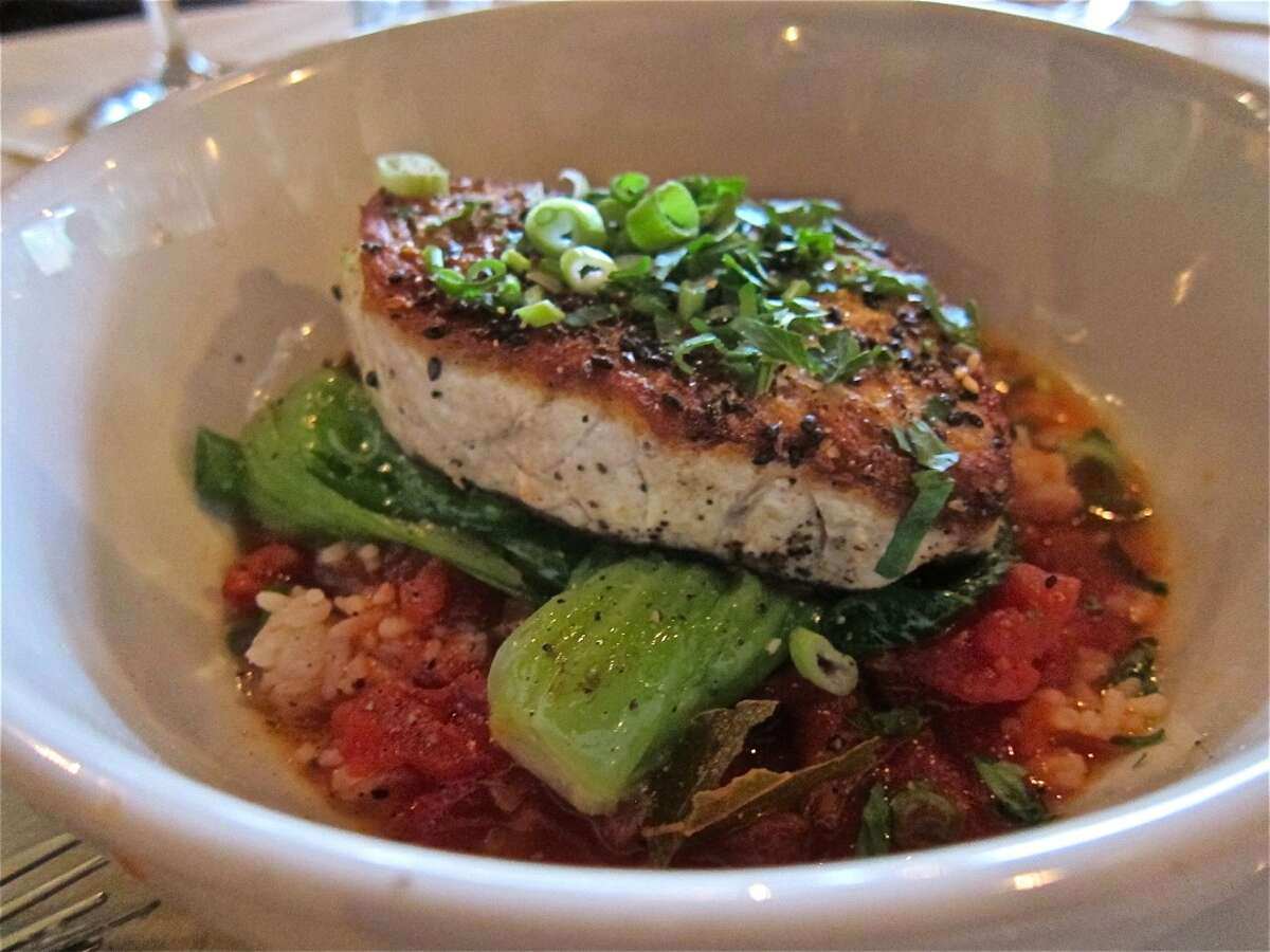 Roasted Gulf swordfish with sweet and sour tomato broth, bok choy and coconut rice at Roost