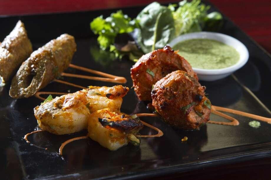 Lamb kebab, Peshawari chicken tikka and Nilaufari Jhinga and Great W'Kana Photo:  ( Brett Coomer / Houston Chronicle )