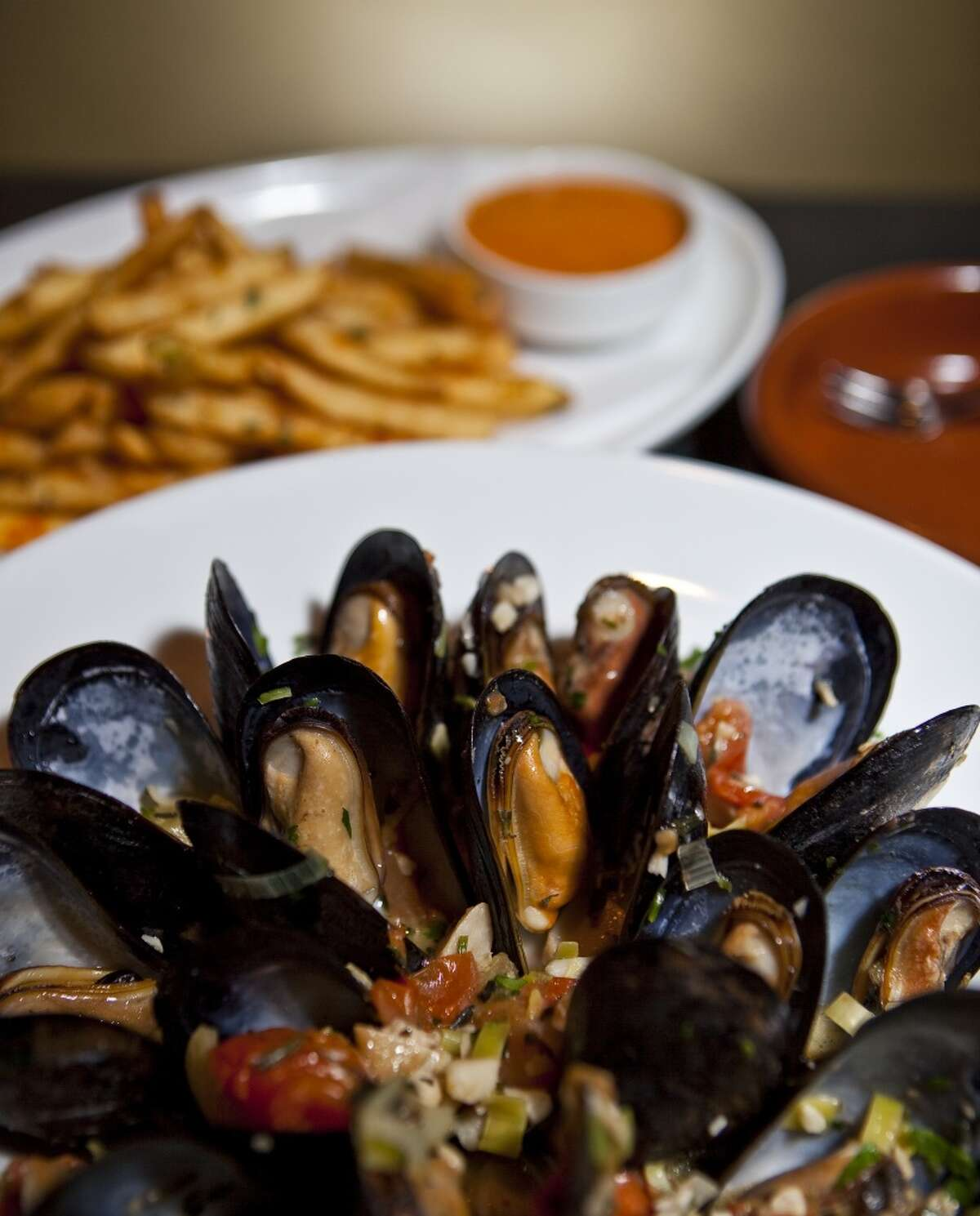 38. Costa Brava Cuisine: Spanish Entree price: $$-$$$ Where: 5115 Bellaire Phone: 713-839-1005 Website: costabravabistro.com Read Alison Cook's review of Costa Brava Pictured above: Steamed mussels and french fries