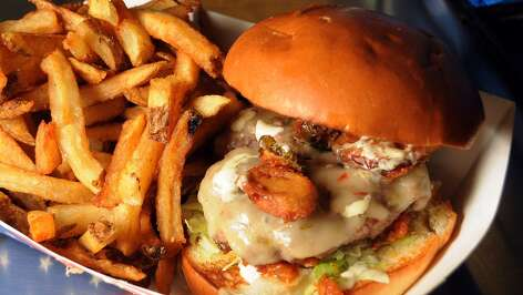 "45. Bernie's Burger Bus     Cuisine:  Burgers/sandwiches    Entree price:  $-$$    Where:  5407 Bellaire    Phone:  713-349-9400    Website:   berniesburgerbus.com     Read Alison Cook's review of Bernie's Burger Bus     Pictured above:  The ""cheerleader"" burger"