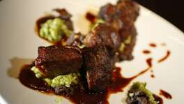 49. Americas  					  Cuisine:  South American   Entree price:  $$-$$$$   Where/phone:  2040 W. Gray, 832-200-1492; 21 Waterway, The Woodlands, 281-367-1492   Website:   cordua.com/americas    Read Alison Cook's review of Americas    Pictured above:  Carnitas