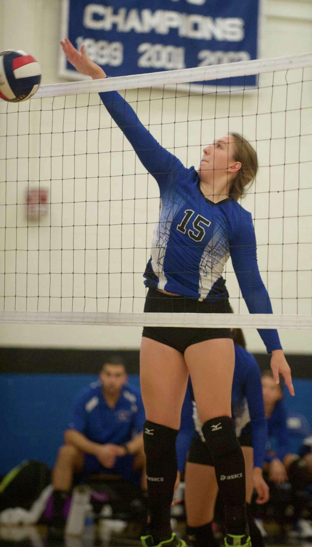 Tech's Marissa Shamansky (15) goes up for a block during the girls high school volleyball game between Bullard Haven and Abbott Tech, on Wednesday, September 24, 2014, in Danbury, Conn.