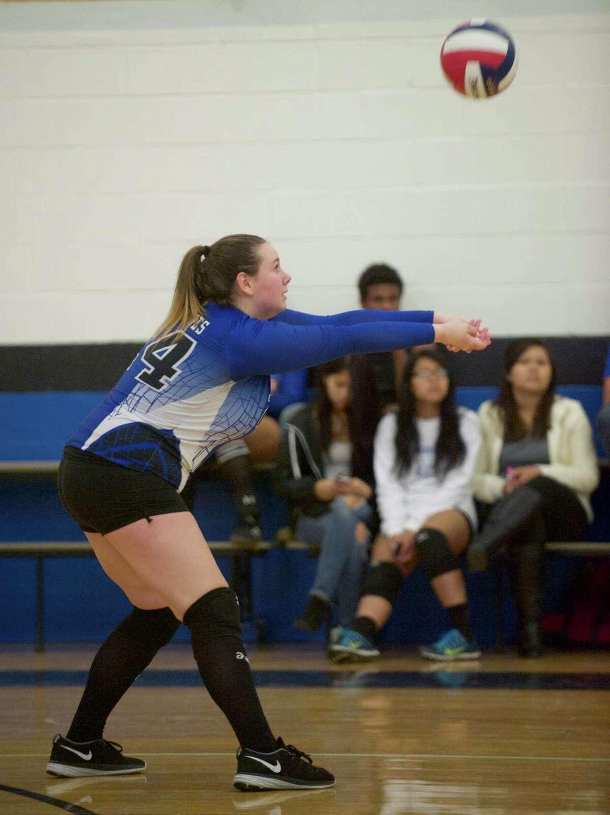 Tech's Amber Horvath (24) returns a serve during the girls high school volleyball game between Bullard Haven and Abbott Tech, on Wednesday, September 24, 2014, in Danbury, Conn.