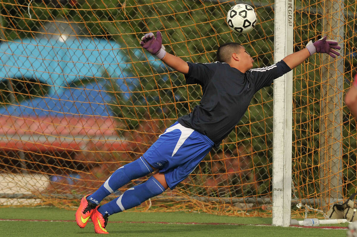 Greenwich goalie Jose Romero dives unsuccessfully for the ball resulting in a goal for Stamford's Leao Valladares during their soccer game at Stamford High School in Stamford, Conn., on Wednesday, Sept. 24, 2014. Stamford won, 4-2.