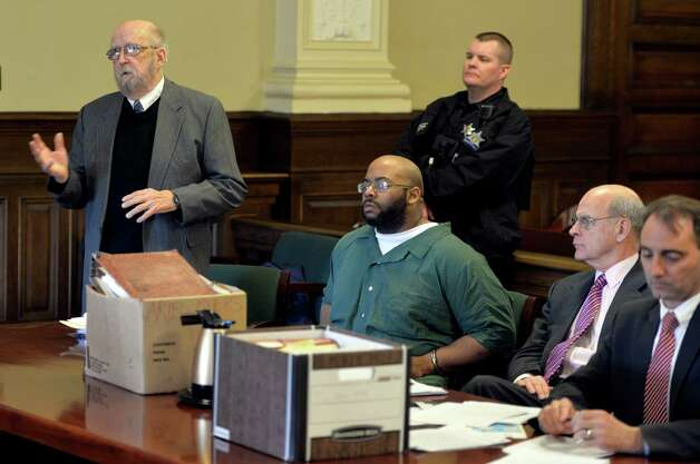 Adrian Thomas, the Troy father whose murder conviction was reversed by the New York State Court of Appeals, appears in Rensselear County Court Wednesday afternoon, March 5, 2014, in Troy, N.Y.  Thomas, second from left is joined by: Jerome Frost, left, attorney Steve Coffey, second from right, and Rensselaer County Public Defender John Turi, right. (Skip Dickstein / Times Union) Photo: SKIP DICKSTEIN / 00026018A
