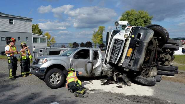 Four cars were seriously damaged after a dump truck rolled over at the intersection of Plains Road and Route 9P near Saratoga Lake this afternoon Sept. 24, 2014 in Malta, N.Y.  There were injuries but none that were life threatening.    (Skip Dickstein/Times Union) Photo: SKIP DICKSTEIN