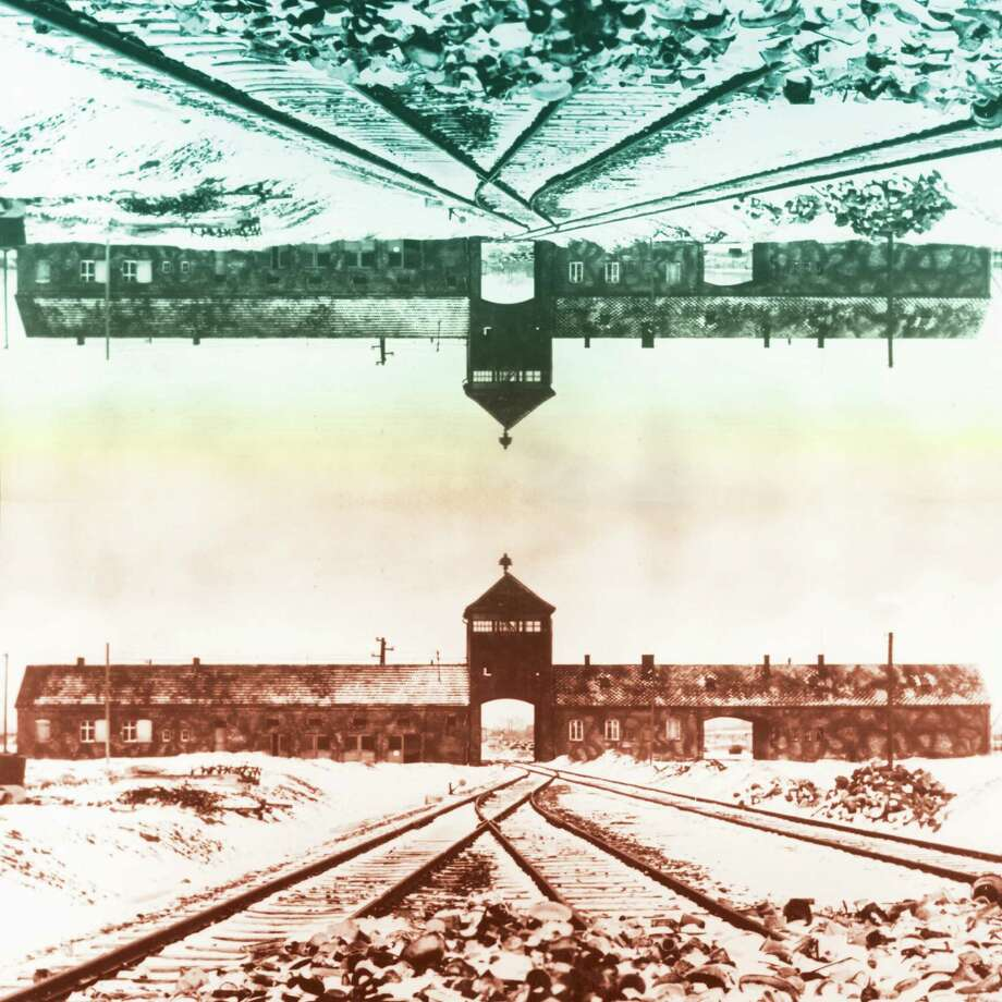 This illustration shows the entry to the concentration camp Auschwitz-Birkenau in Poland, with snow-covered railtracks leading to the camp.