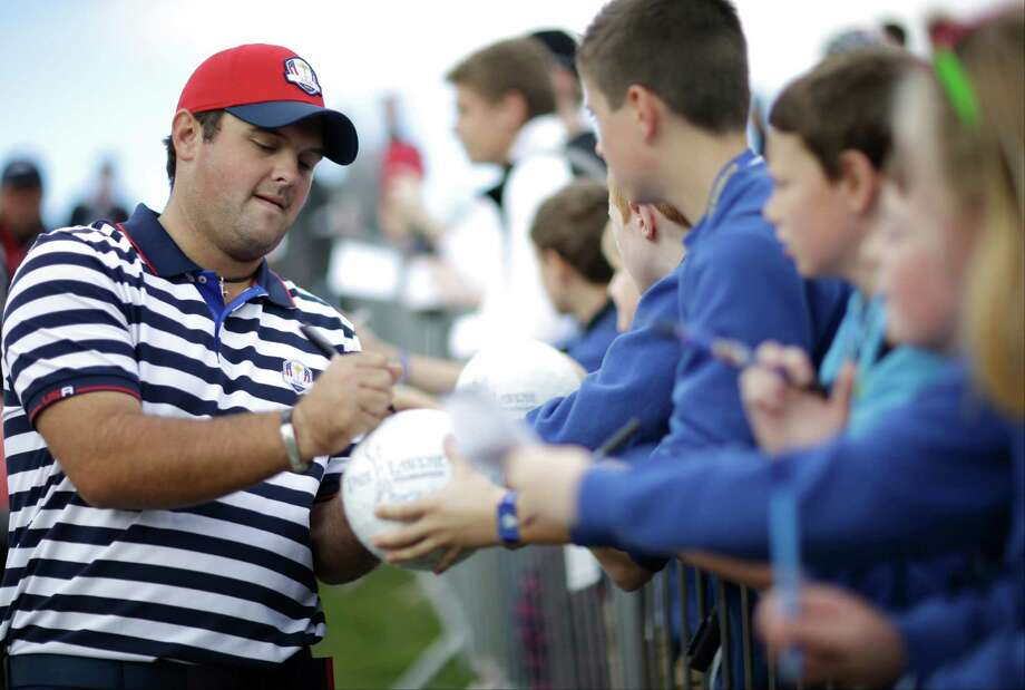 Ryder Cup rookie Patrick Reed of Spring obliges autograph seekers during a practice round Wednesday at Gleneagles. Photo: Matt Dunham, STF / AP