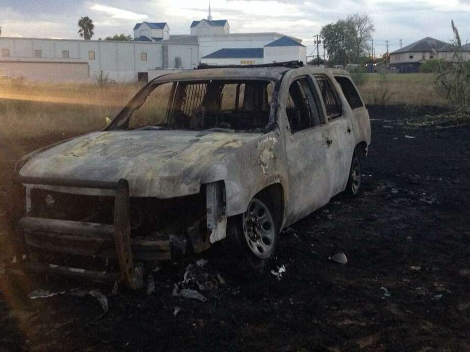 A Bexar County Sheriff's Office patrol SUV went up in flames Wednesday night, Sept. 24, 2014, following a brief chase on San Antonio's Northeast Side. Photo: Mark D. Wilson/San Antonio Express-News